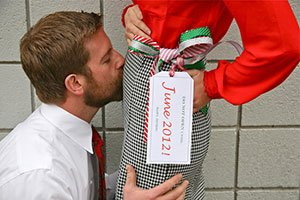 Christmas pregnancy announcements Dad kissing belly