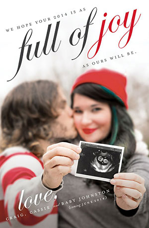 Pregnancy announcement in Christmas card holding a sonogram