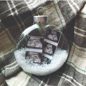 Snowball Christmas ornament to announce pregnancy