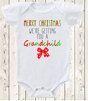 Christmas pregnancy announcement for grandparents with a onsie