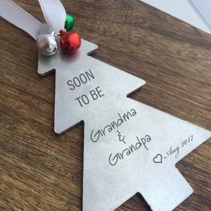 Christmas pregnancy announcement for grandparents with a handmade ornament