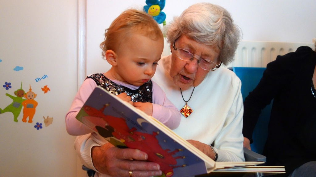 grandmother reading to child about becoming a sibling