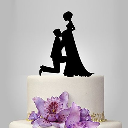 Groom kissing brides stomach pregnant bride wedding cake topper