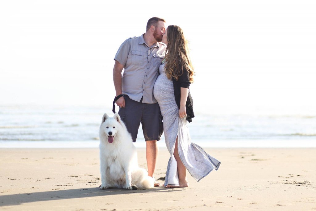 maternity photo shoot at the beach with dog