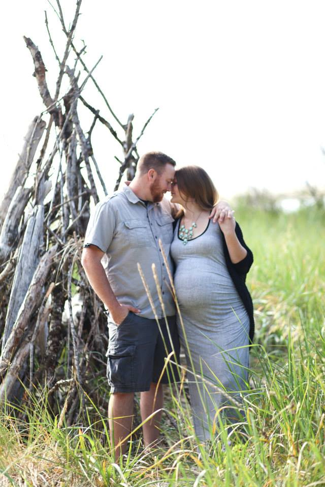 maternity photo shoot at the beach face to face