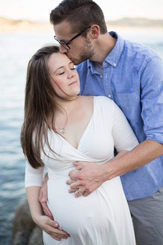 maternity photo shoot at the beach romantic pose