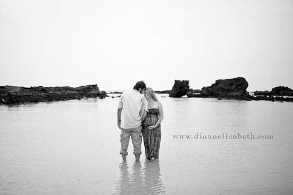 maternity photo shoot at the beach standing in water