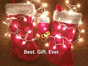 Christmas pregnancy announcement with stockings
