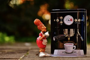 figurine at a coffee maker